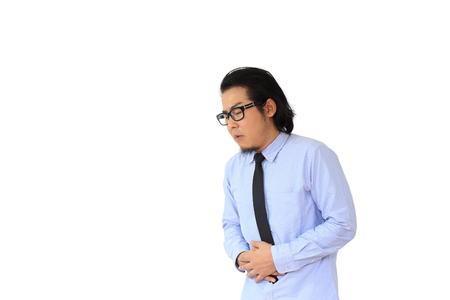 stomachache: The Asian businessman got stomachache. Stock Photo