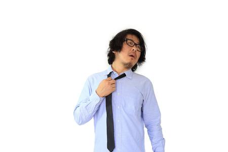 De arme Aziatische zakenman warm gevoel. Stockfoto
