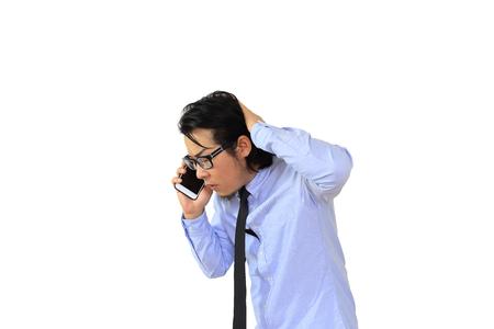 The Asian businessman saying sorry on smartphone. Reklamní fotografie