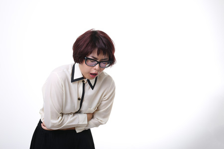 stomachache: The Asian businesswoman getting, stomachache. Stock Photo