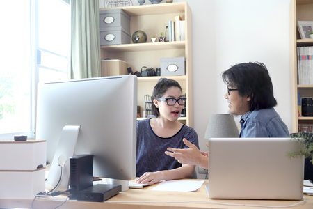 The two asian people working together. Stock Photo