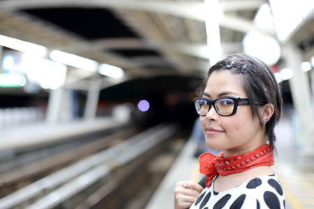 The Asian woman using public train.