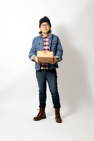 The Asian man standing in the white background Stock Photo
