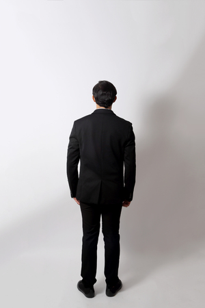 The Asian businessman on the white background.