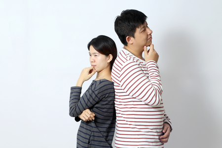 The Asian couple on the white background.