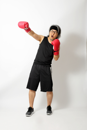 The Asian sport man on the white background. Stock fotó