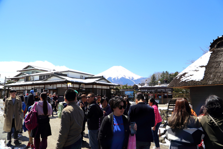 Oshino Hakkai, Japan - April 11, 2019: The tourists visit Oshino Hakkai, the small village near Fuji mountain. Редакционное