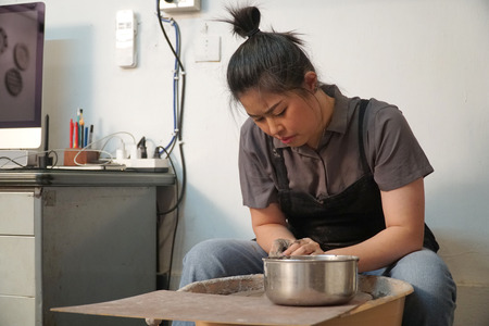 The Asian woman doing craft design works. Stock fotó