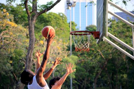 Bangkok, Thailand -March 10, 2013: The sportman playing basketball in the public Lumpini park, Bangkok, Thailand.