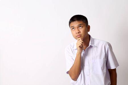 Młody chłopiec student Thai na białym tle. Zdjęcie Seryjne
