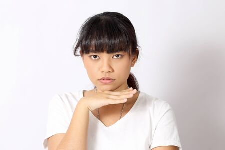 The Asian woman portrait on the white background.