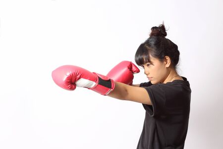 The Asian woman do workout on the white background.