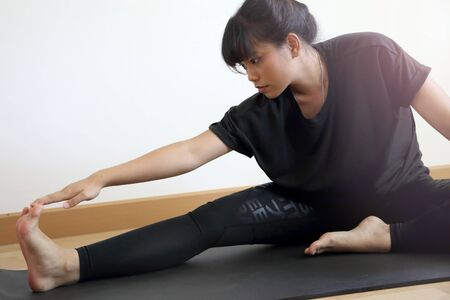 The Asian woman workout in the house.