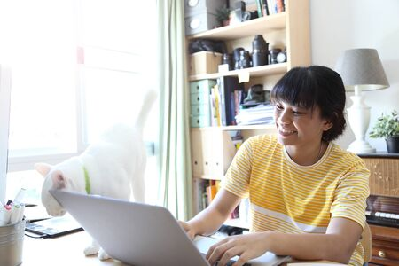 The Asian woman working in home studio.
