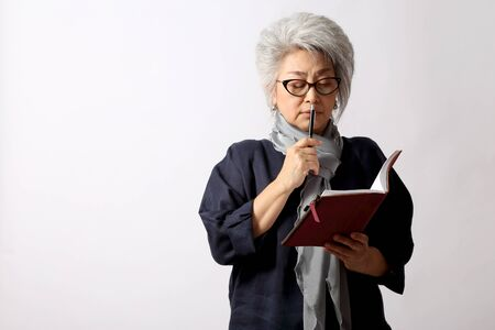 The elder Asian woman on the white background.