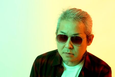The Asian man on the white background with grl color effect light.