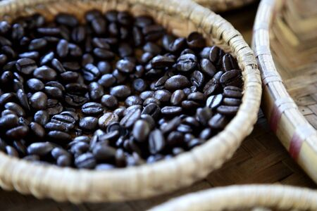 The coffee bean processed in the bamboo tray. Stock Photo