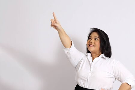 The Asian woman on the white background. Stock Photo