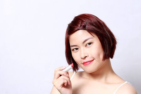 The Asian womans portrait on the white background.