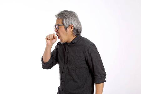 The senior Asian man on the white background.