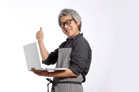 The Asian man with apron.