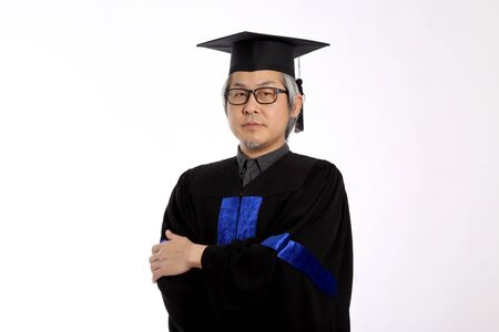 The Asian man with graduation gown..