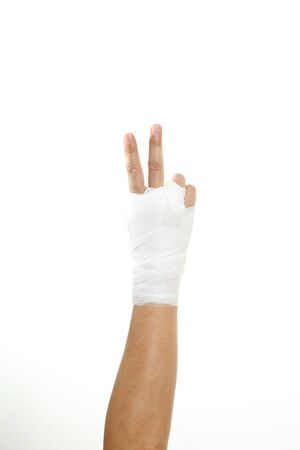 Human's hand with bandage on the white background. Фото со стока