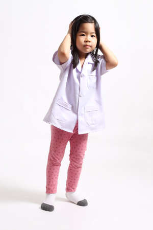 The young Asian girl in the physician uniform.