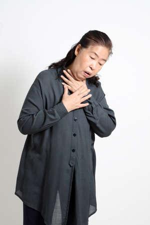 The Asian senior woman on the white background.