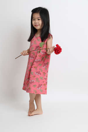 The Asian girl holding big flower on the white background.