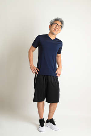 The Asian senior man with sport clothes on the white background. Stock fotó