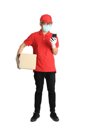 The senior Asian postman with face mask on the white background.