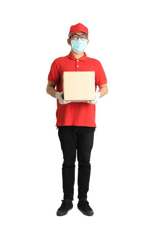 The senior Asian postman with face mask on the white background. Banque d'images