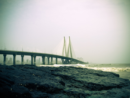 The Bandra-Worli Sea Link, officially called Rajiv Gandhi Sea Link, is a cable-stayed bridge that links Bandra in the Western Suburbs of Mumbai with Worli in South Mumbai.
