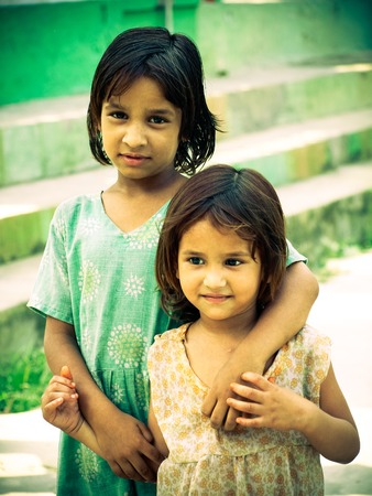 rural india: Rural smiling girls sisters closeup morning in sunlight Amroha, Uttar pradesh, India