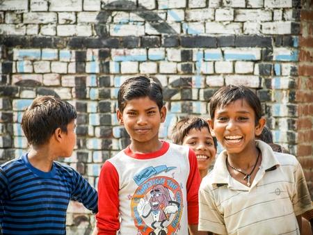 Amroha, Uttar Pradesh, INDIA - 2011: Indian children of slams smilimg boys Редакционное