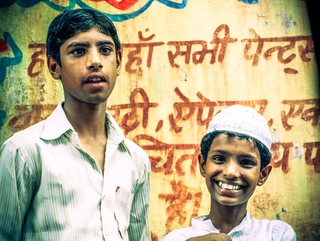 portrait of smiling Muslim boy.Image taken at Amroha, Uttar Pradesh,India. on summer 2011