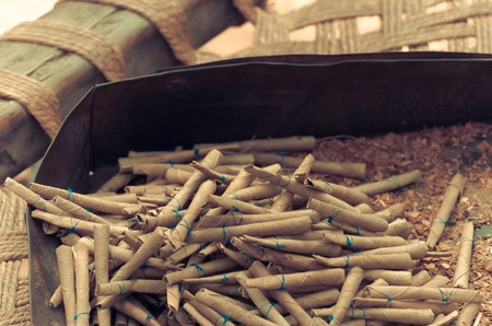 The beedi is a thin, Indian cigarette filled with tobacco flakes and wrapped in a Bauhinia racemosa leaf and tied with a string at one end.