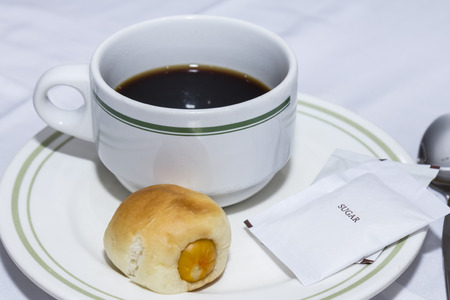 time's: Coffee cup and bun  for breaking times to meet.