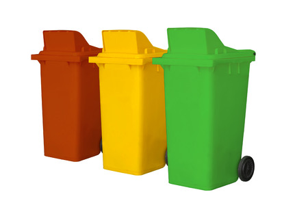 segregate: Large colorful trash cans garbage bins with wheel collection on white background and Clipping path.