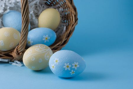 Easter eggs with basket on a blue background