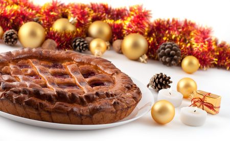 Pie and Christmas decorations on a white background Stock Photo