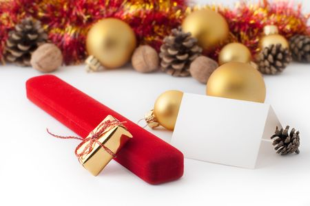 Christmas gift with blank note on a white background Stock Photo