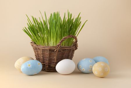 Easter eggs and basket with green grass Stock Photo