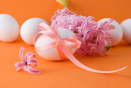 Easter eggs with a ribbon and hyacinth