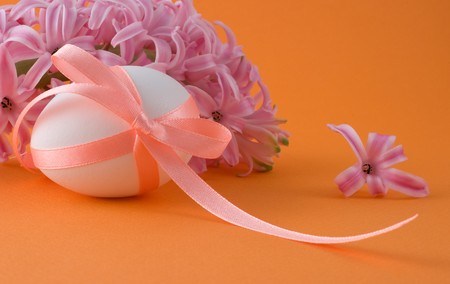 Easter egg with a ribbon and hyacinth