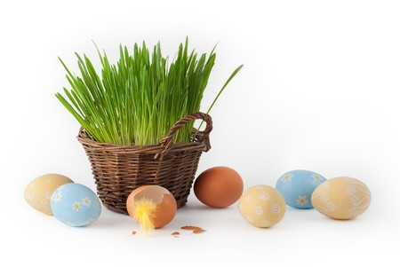Easter eggs and basket with grass