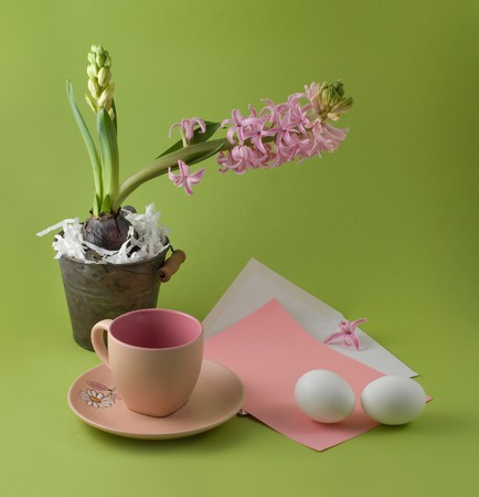 Letter with easter congratulation and teacup