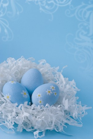 Three blue easter eggs on a blue background