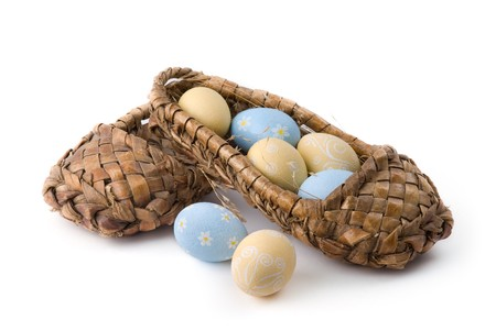 Easter eggs in bast shoes on a white background Stock Photo
